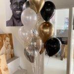 Grote tros heliumballonnen goud, wit, zwart, confetti goud